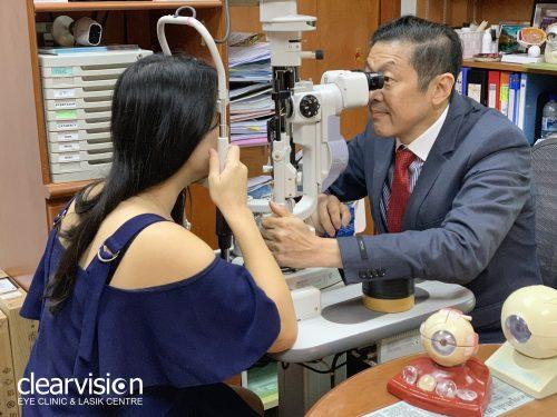 dr ho doing eye check